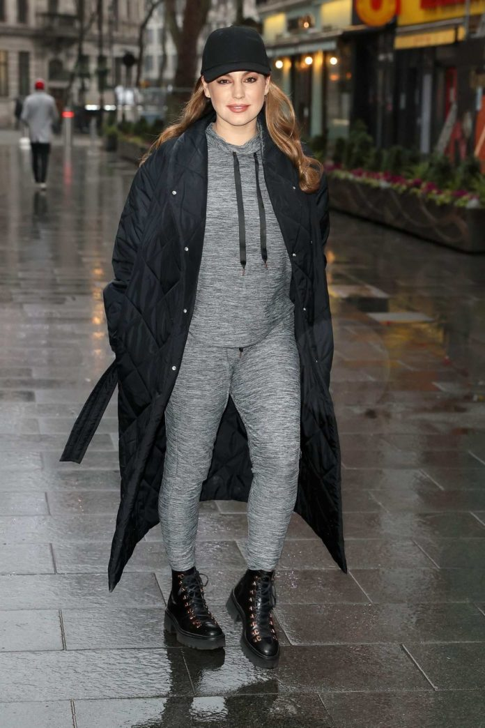 Kelly Brook looks stunning in casuals as she steps out in grey joggers with full-length coat and boots in London, UK