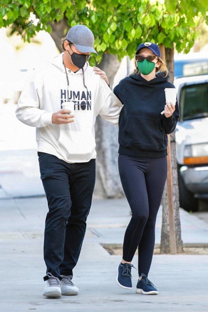 Katherine Schwarzenegger and Chris Pratt wrap their arms around each other while out for a walk in Brentwood, California